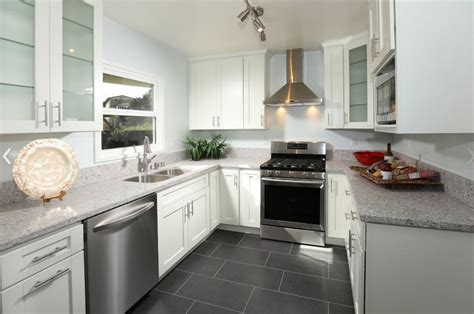 grey tile floors white cabinets modern kitchen with grey tile floor and white cabinets