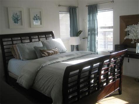 blue brown bedroom sleigh bed cottage bedroom hgtv