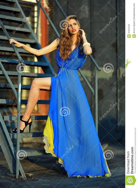 Dress Model Blue Fashion Impor fashion model posing wearing blue evening dress on rooftop location stock photography