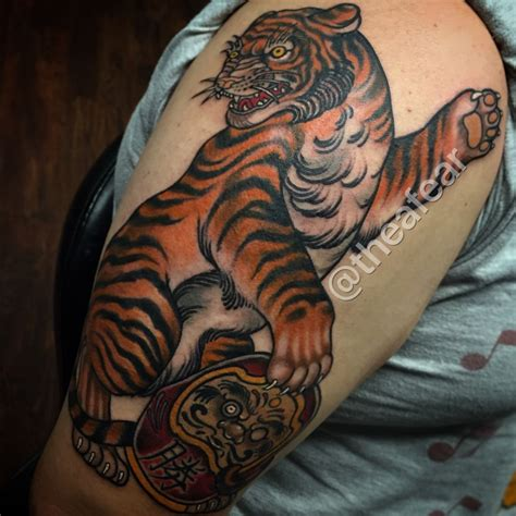 neo japanese tattoo neo traditional japanese tiger and daruma doll by