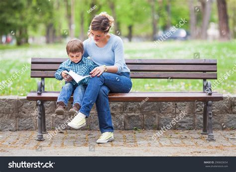 bench reading mother son sitting on bench park stock photo 290603654 shutterstock
