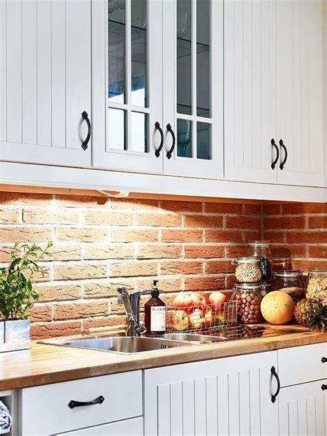 exposed brick kitchen backsplash backsplash pinterest creamy white cabinets with red brick back splash raw