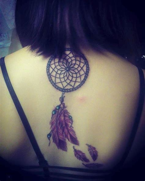 dreamcatcher tattoo back piece blue feathers and dream catcher tattoo on rib cage