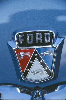 stock photo  ford red white blue hood emblem  sedan