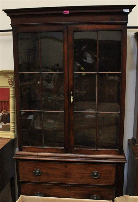 a 19th century mahogany bookcase enclosed by a pair of