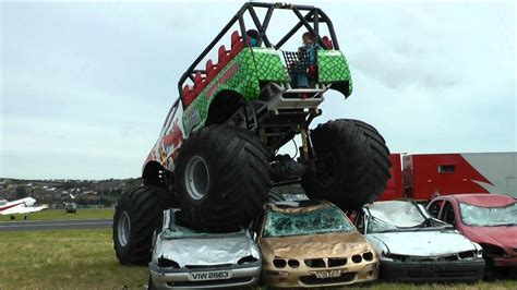 videos of monster trucks crushing cars monster truck crushing cars youtube