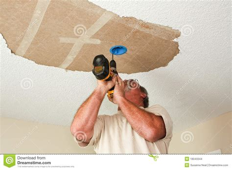 how to hang a l from the ceiling electrician installing light fixture on ceiling stock