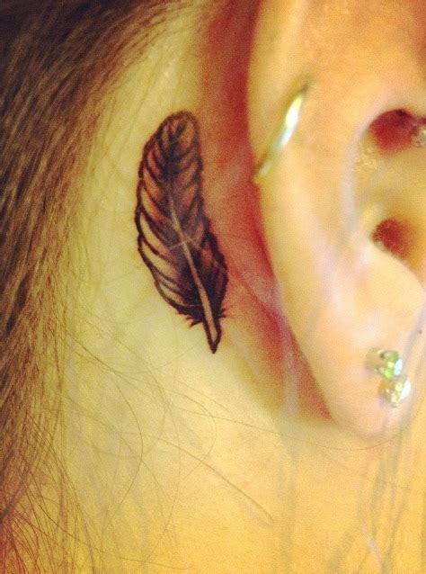 small behind the ear tattoo small feather ear hairstyle 2013