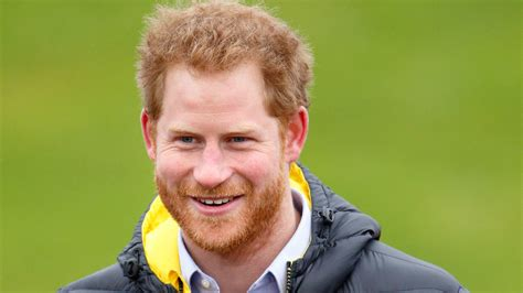 prince harry prince harry helps disabled athlete after wind knocks
