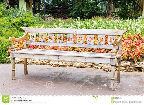 beautiful garden benches wooden bench in beautiful garden background stock photo