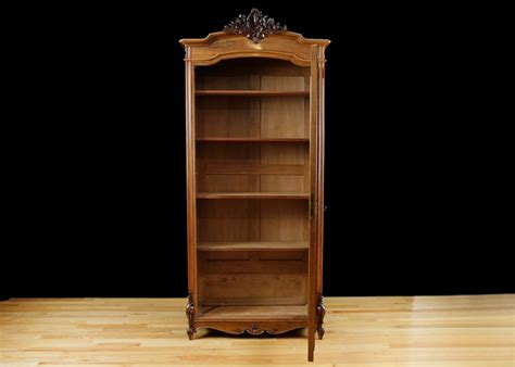 antique bookcase in walnut with glass panel