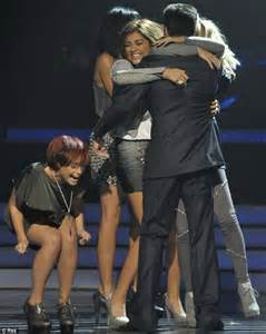 Victory: Belle Amie hug mentor Simon Cowell as they find out they have