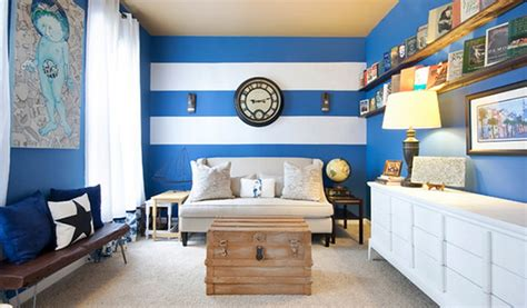 blue striped walls create a modern living room with striped walls