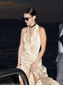 Serious Wardrobe by Hadid Nearly Suffers A Serious Wardrobe In Gold Silk Dress With Dangerously High