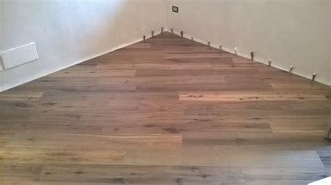posa piastrelle diagonale pavimento in legno guidetti marmo parquet