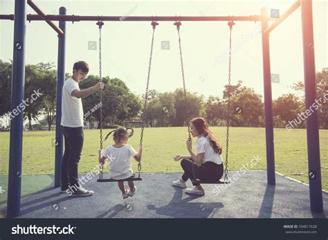 swing her happy kids playing swing her mother stock photo 594817628