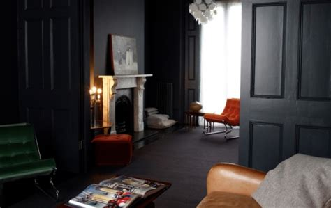 dark interior black walls with black trim door sixteen