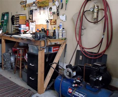 Setting Up A Home In The Garage by Set Up Garage Workshop