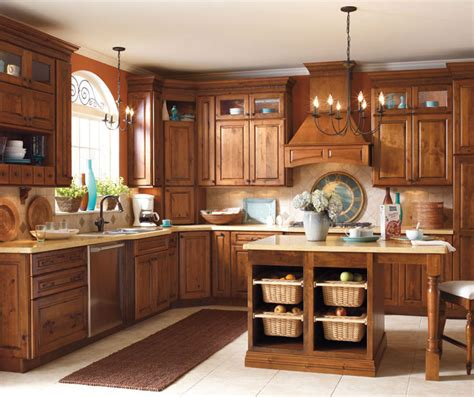 rustic kitchen cabinets pictures rustic alder kitchen cabinets schrock cabinetry