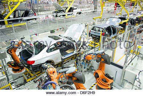 bmw factory robots robots at work in car factory stock photo 53093817 alamy