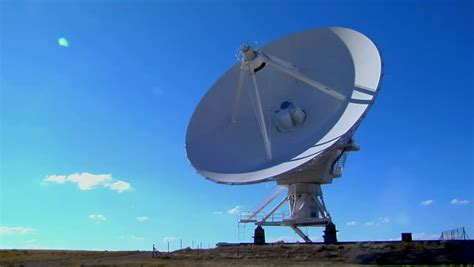 a satellite dish in time lapse against a beautiful sky stock footage 1603555