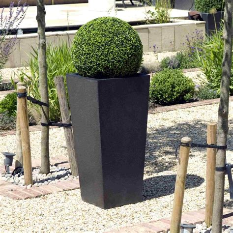 Planters Uk by Cadix Tapered Planters 2 Colours And 3 Sizes
