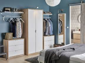 bedroom with a wardrobe in oak effect with white doors combined with