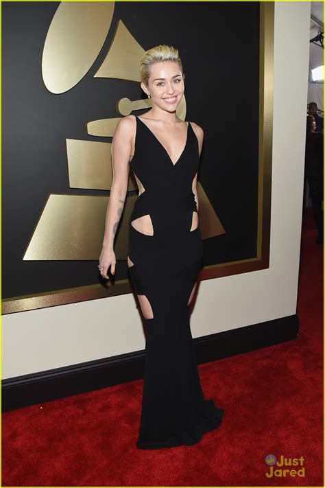 2015 grammy awards red carpet upi com miley cyrus goes sleek in black at the grammys 2015