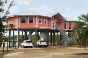 Hurricane proof home on pilings stilt house home front view beach