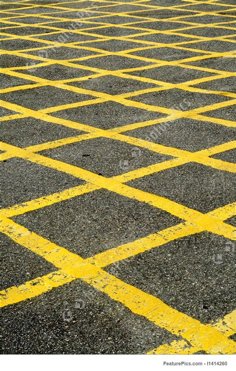 pattern of yellow lines on the roadway abstract patterns closeup of the yellow lines of a