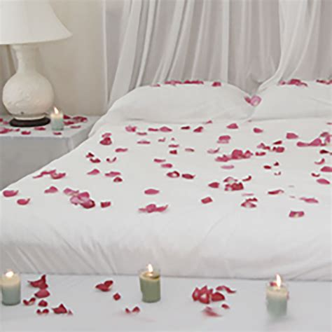 romance in bed romantic bed romance in bed petals roses