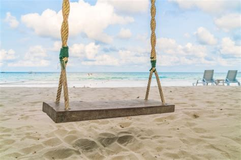 swings on the beach a swing on the beach photo free download