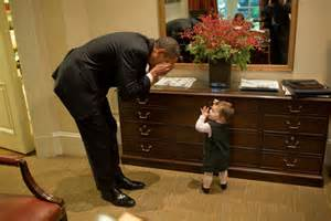 President barack obama plays peek a boo with maeve beliveau