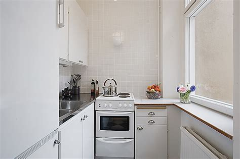 Tiny Apartment Kitchen | clean white small apartment interior design with
