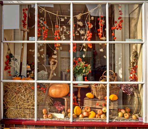 7 Window Decorations by An Autumn Harvest Theme For A Display In A Shop Window At