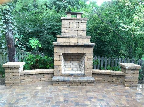 outdoor fireplace with wing walls columns and brick paver