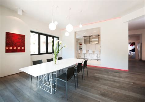 a super minimalist modern apartment in white red white apartment