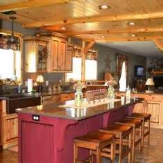 cabinets michigan: rustic but elegant kitchen with warm knotty pine cabinets featuring an