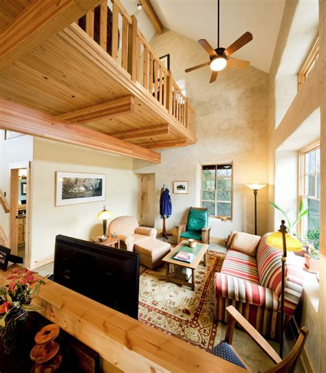 build a living room green cottage family room with loft above rustic