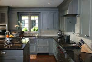 Grey cabinets with black counters wood floors countertops color