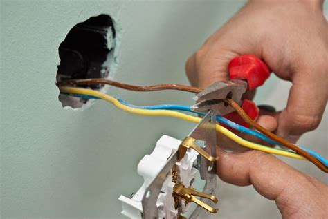 cutting electrical wire how to wire and install an electric outlet