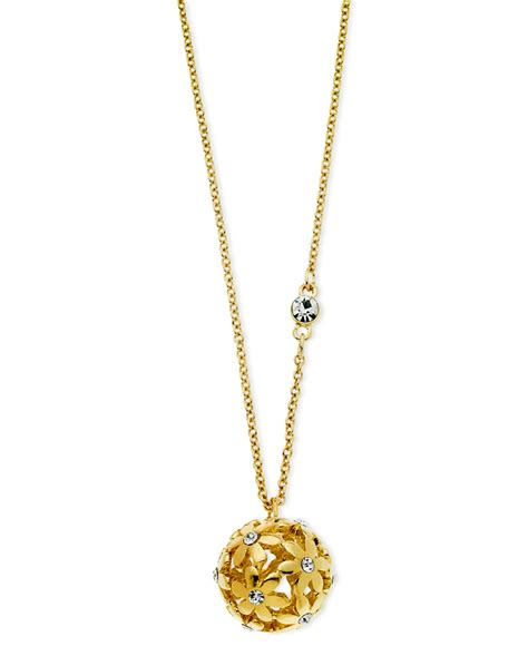 guess gold tone flower pendant necklace in metallic