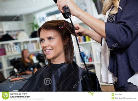a woman gets a new at stock image image of hair dryer