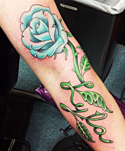 name in a rose tattoo show your devoted through name
