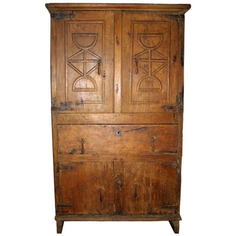 primitive armoire rare primitive cabinet armoire with celtic carving at