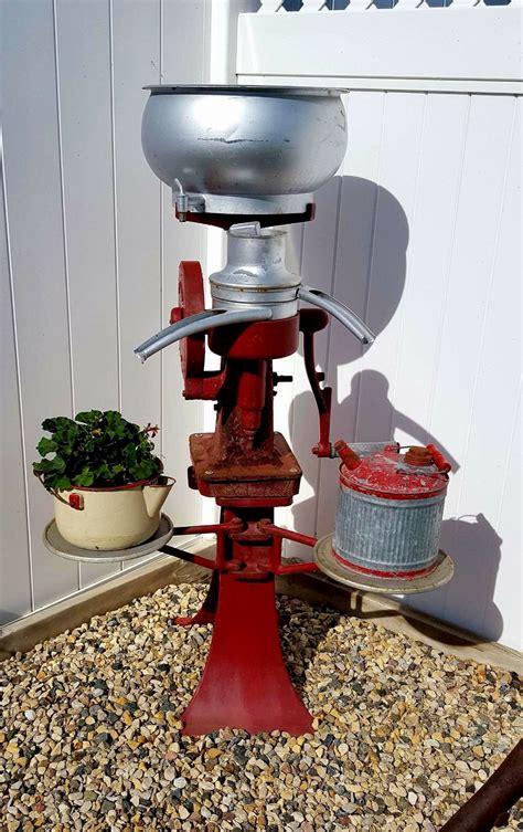 antique cream separators work   yard decor  plant