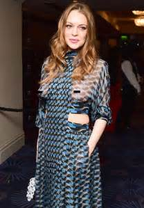 Lindsay lohan happily flashes her breasts in sheer gown at british