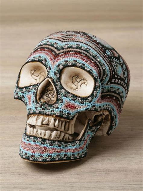 stunning colorful beaded skulls inspired by huichol