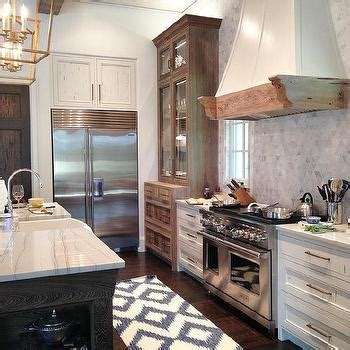 white pecky cypress kitchen cabinets with navy blue island white pecky cypress kitchen cabinets with navy blue island