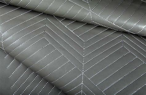 shiny quilted vinyl upholstery fabric in grey modern